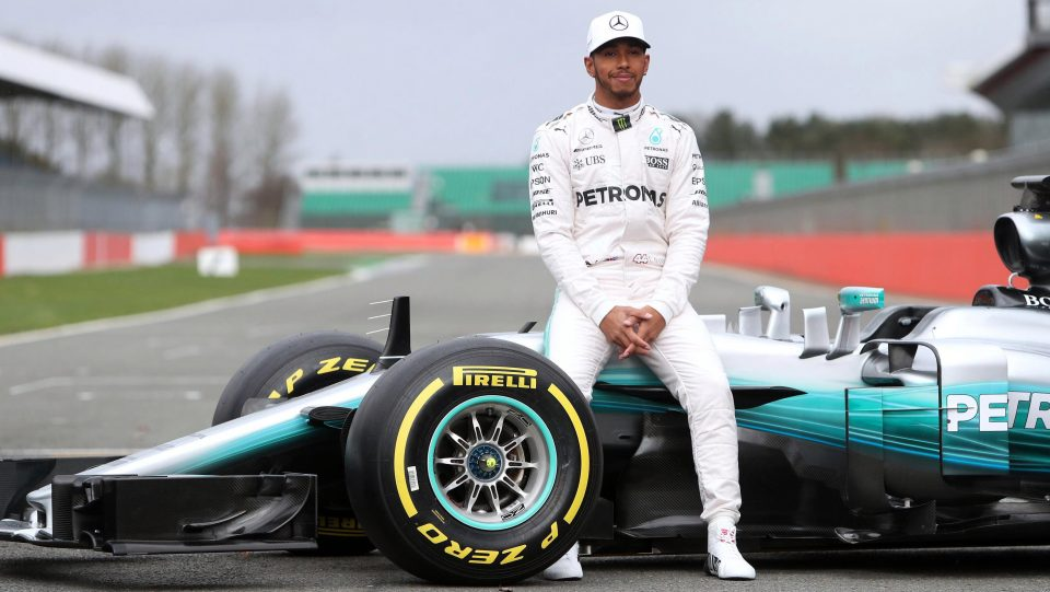 Lewis Hamilton sitting on F1 Car
